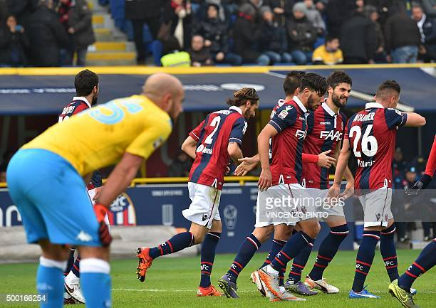 Bologna's defender from Italy Luca Rossettini celebrates with teammates after scoring during the Italian Serie A football match Bologna vs Napoli at...