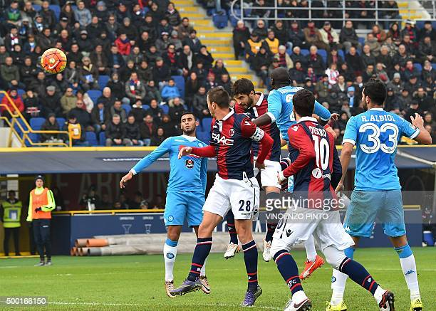 Bologna's defender from Italy Luca Rossettini scores against Napoli during the Italian Serie A football match Bologna vs Napoli at the Dall'Ara...