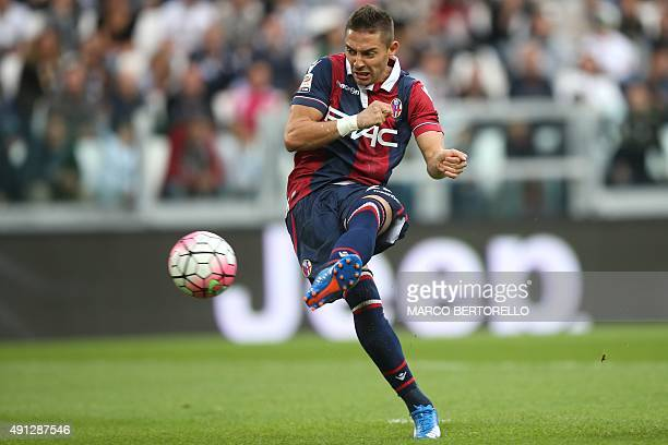 Bologna's forward Anthony Mounier kicks and scores during the Italian Serie A football match Juventus Vs Bologna on October 4 2015 at the 'Juventus...