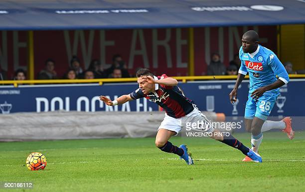 Bologna's forward from France Antony Mounier vies with Napoli's defender from France Kalidou Coulibaly during the Italian Serie A football match...