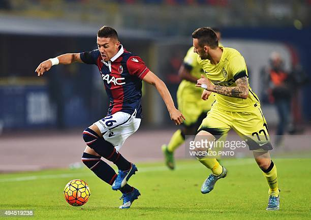 Bologna's forward Mounier Anthony vies with Inter Milan's Croatian midfielder Marcelo Brozovic during the Serie A football match Bologna vs...