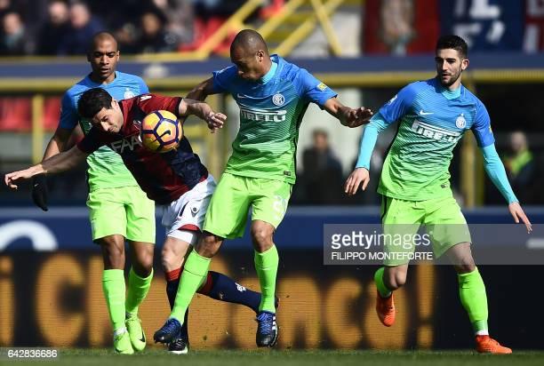 Bologna's Hungarian midfielder Adam Nagy vies with Inter Milan's Brazilian defender Joao Miranda during the italian Serie A football match Bologna vs...