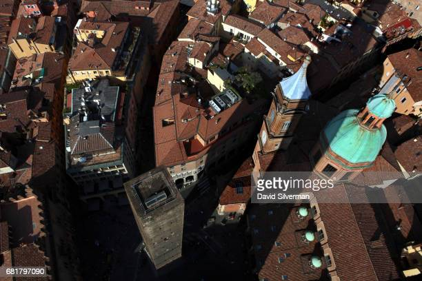 Bologna's iconic Two Towers Le Due Torri of Garisenda and Asinelli cast their shadows over the city center and the domed Parish of Santi Bartolomeo...