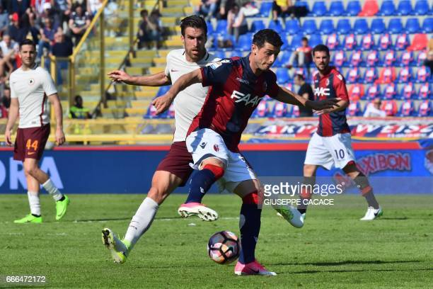 Bologna's midfielder from Switzerland Blerim Dzemaili fights for the ball with Roma's midfielder from Netherlands Kevin Strootman during the Italian...