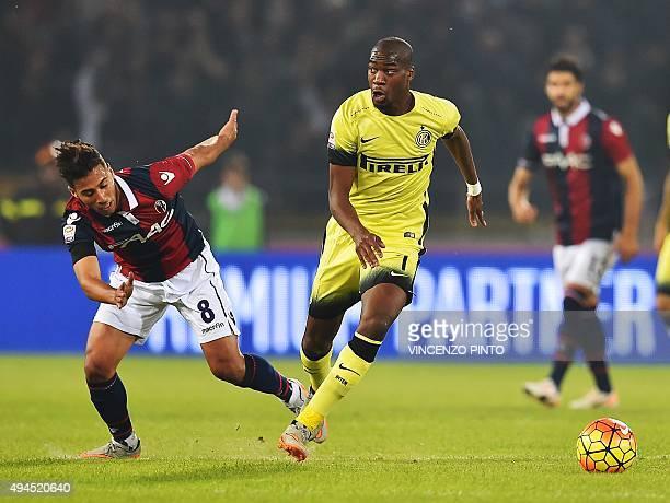 Bologna's midfielder Saphir Taider vies Inter Milan's French midfielder Geoffrey Kondogbia during the Serie A football match Bologna vs InterMilan at...
