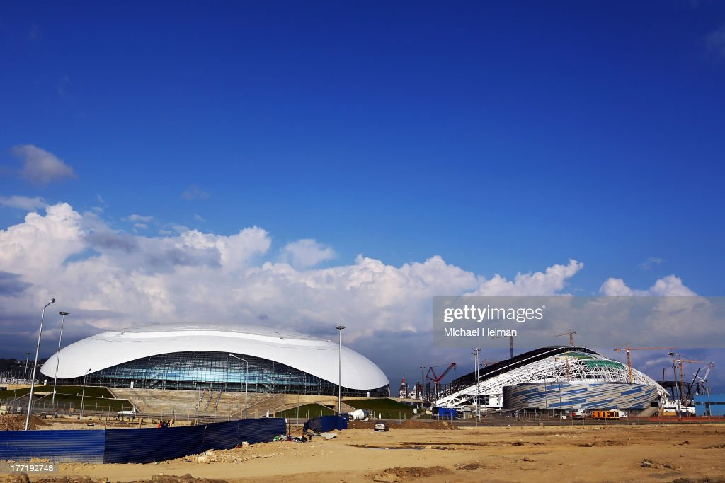 Bolshoy Ice Dome (L), Shayba Arena (R) and Fisht Olympic Stadium (behind) are seen as construction continues on August 21, 2013 in Sochi, Russia.