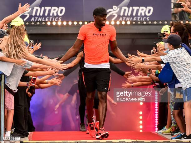 TOPSHOT Bolt All Stars Captain Usain Bolt of Jamaica leads his team out during the Nitro Athletics meet in Melbourne on February 9 2017 The inaugural...