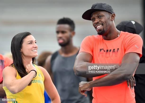 Bolt All Stars Captain Usain Bolt of Jamaica speaks with Australian athlete Michelle Jenneke during the Nitro Athletics meet in Melbourne on February...