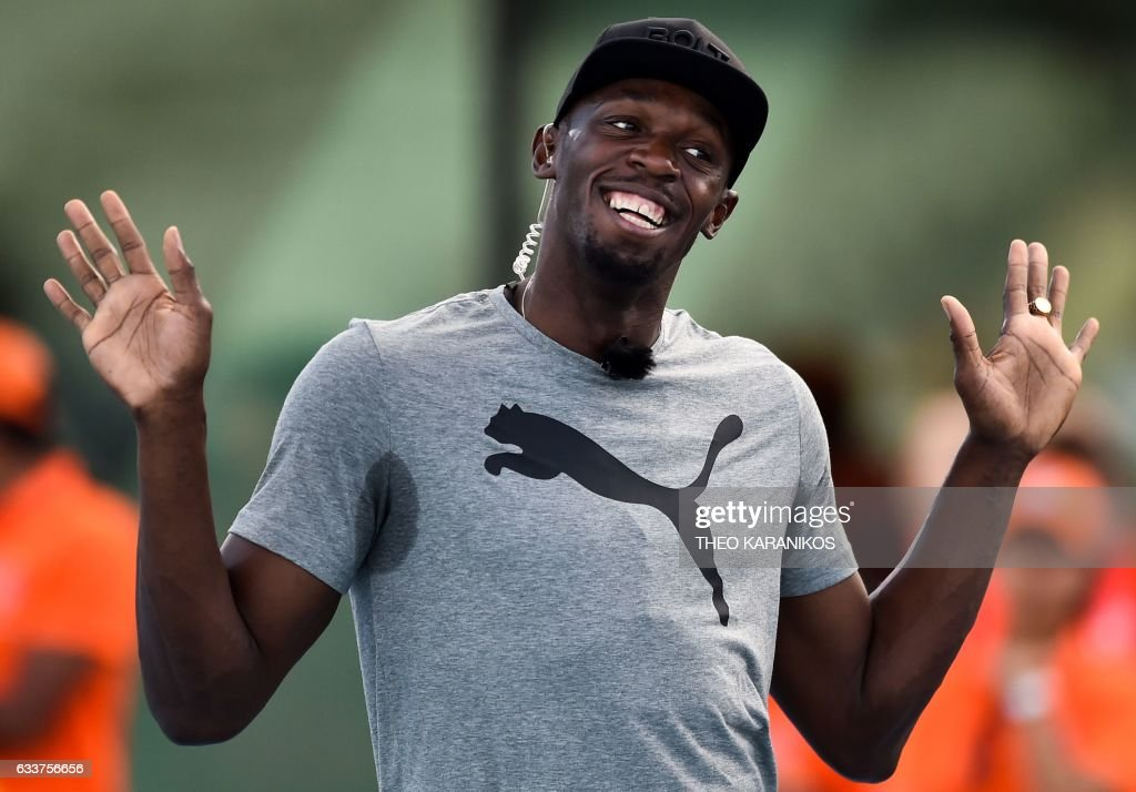 Bolt All Stars team captain Usain Bolt of Jamaica gestures during the Nitro Athletics meet in Melbourne on February 4, 2017. The inaugural Nitro Athletics in Melbourne, which will also be held on February 9 and 11, features non-traditional events such as middle-distance and hurdles relays. / AFP PHOTO / Theo Karanikos / IMAGE
