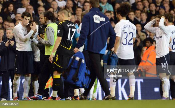 Bolton and Tottenham players wait anxiously whilst the medical team perform CPR on Fabrice Muamba of Bolton after he collapsed on the pitch suffering...