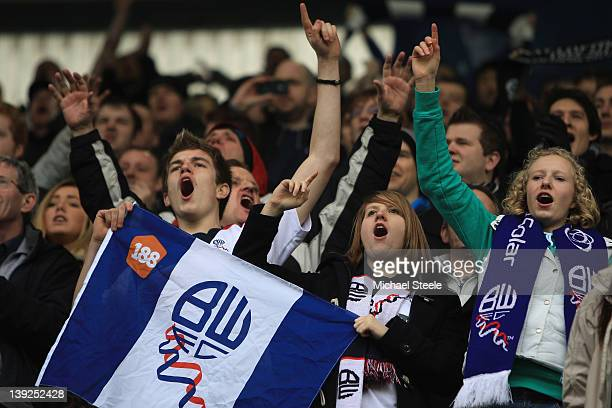 Bolton fans sing during the FA Cup fifth round match between Millwall and Bolton Wanderers at The Den on February 18 2012 in London England