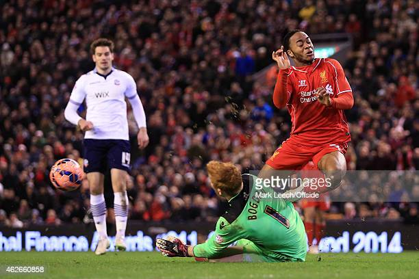 Bolton goalkeeper Adam Bogdan saves from Raheem Sterling of Liverpool during the FA Cup Fourth Round match between Liverpool and Bolton Wanderers at...