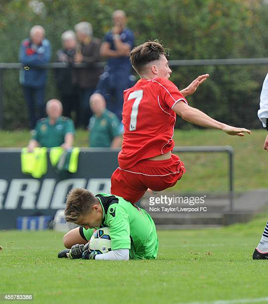 Bolton goalkeeper Will Jaaskelainen saves the ball from the feet of Liverpool's Harry Wilson during the Barclays Premier League Under 18 fixture...