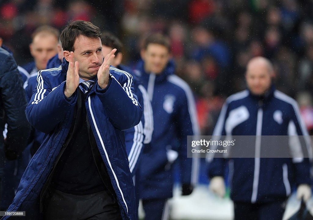 Bolton manager <a gi-track='captionPersonalityLinkClicked' href=/galleries/search?phrase=Dougie+Freedman&family=editorial&specificpeople=710974 ng-click='$event.stopPropagation()'>Dougie Freedman</a> applauds the the Crystal Palace fans during the npower Championship match between Crystal Palace and Bolton at Selhurst Park on January 19, 2013 in London England.