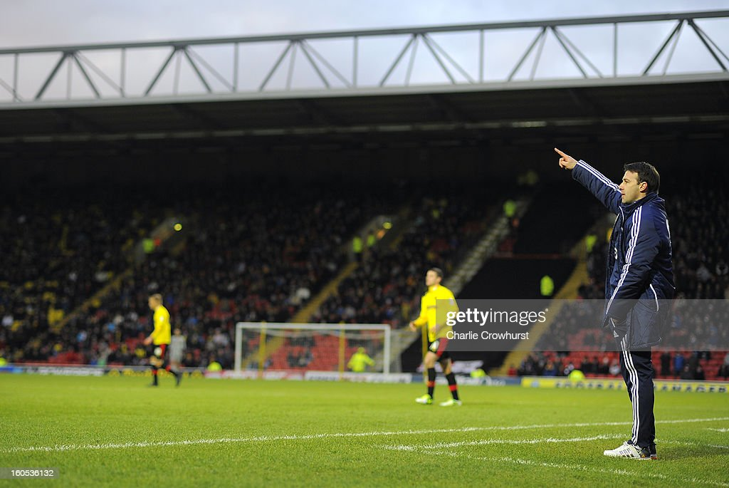 Bolton manager <a gi-track='captionPersonalityLinkClicked' href=/galleries/search?phrase=Dougie+Freedman&family=editorial&specificpeople=710974 ng-click='$event.stopPropagation()'>Dougie Freedman</a> gestures during the npower Championship match between Watford and Bolton Wanderers at Vicarage Road on February 02, 2013 in Watford England.