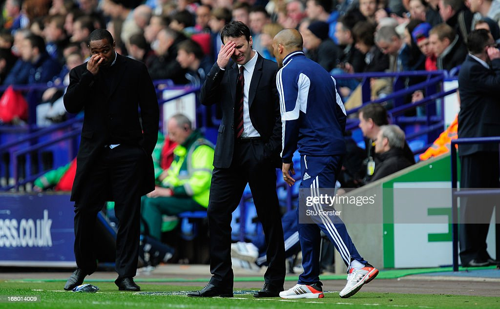 Bolton manager Dougie Freedman (c) reacts during the npower Championship match between Bolton Wanderers and Blackpool at Reebok Stadium on May 4, 2013 in Bolton, England.