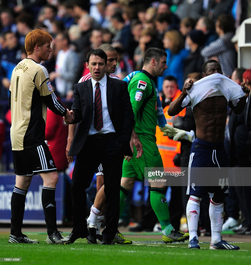 Bolton manager Dougie Freedman (c) shakes hands with keeper Adam Bogdan (l) as Medo Kamara (r) reacts the npower Championship match between Bolton Wanderers and Blackpool at Reebok Stadium on May 4, 2013 in Bolton, England.