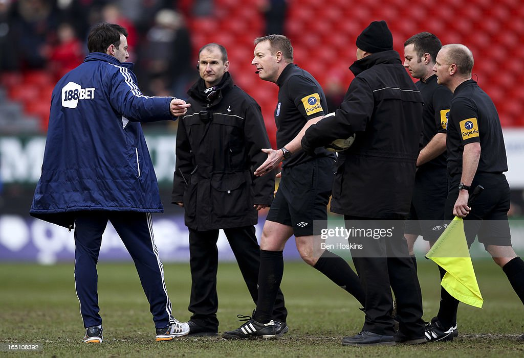 Bolton manager <a gi-track='captionPersonalityLinkClicked' href=/galleries/search?phrase=Dougie+Freedman&family=editorial&specificpeople=710974 ng-click='$event.stopPropagation()'>Dougie Freedman</a> speaks with referee Trevor Kettle during the npower Championship match between Charlton Athletic and Bolton Wanderers at the Valley on March 30, 2013 in London, England.