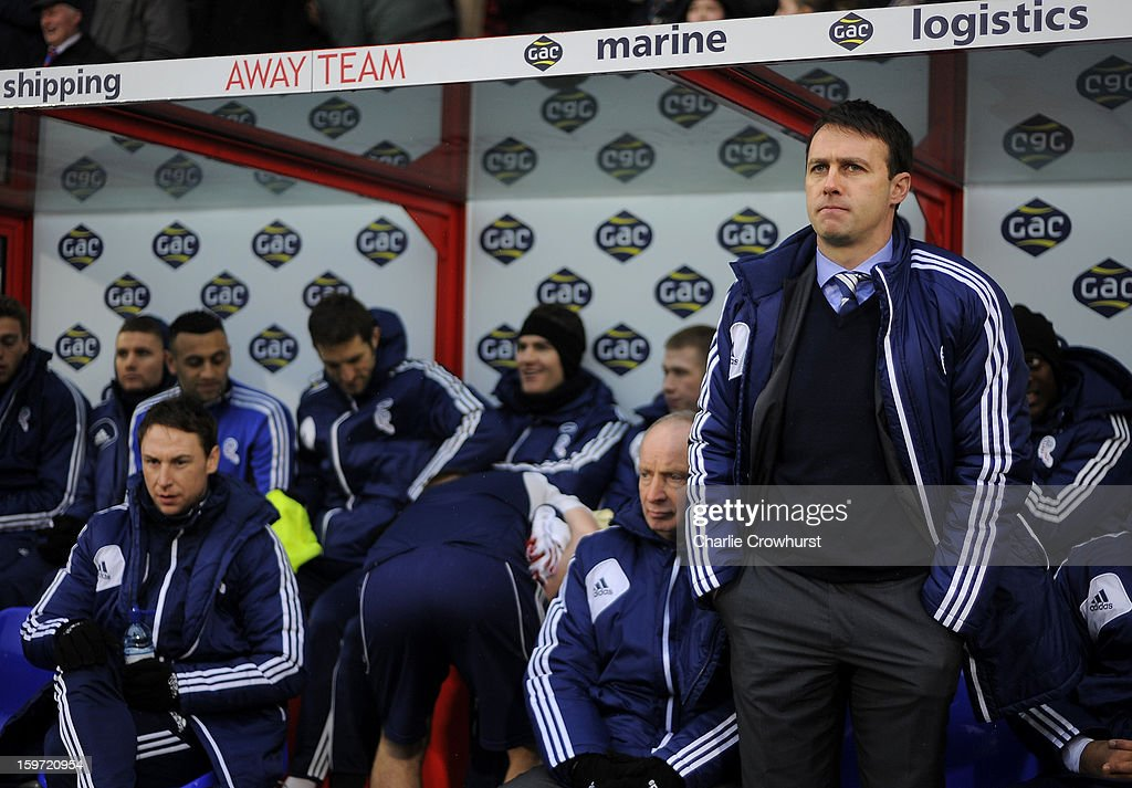 Bolton manager Dougie Freedman stands in the dugout during the npower Championship match between Crystal Palace and Bolton at Selhurst Park on January 19, 2013 in London England.