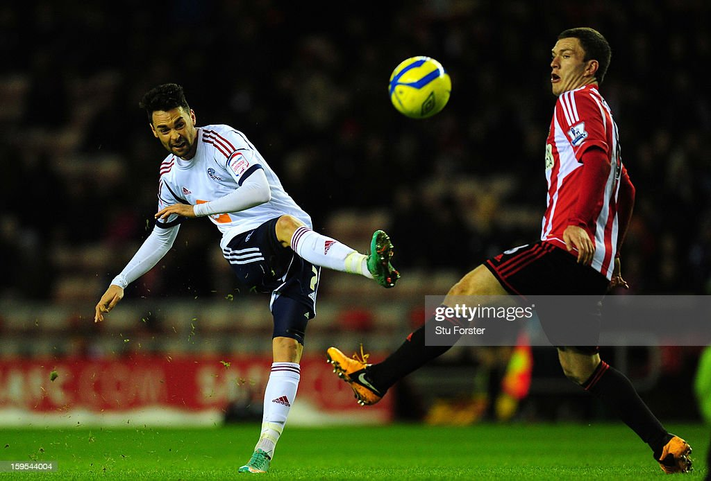Bolton player <a gi-track='captionPersonalityLinkClicked' href=/galleries/search?phrase=Chris+Eagles&family=editorial&specificpeople=214542 ng-click='$event.stopPropagation()'>Chris Eagles</a> (l) gets in a shot at goal despite the challenge of Sunderland player <a gi-track='captionPersonalityLinkClicked' href=/galleries/search?phrase=Craig+Gardner&family=editorial&specificpeople=685283 ng-click='$event.stopPropagation()'>Craig Gardner</a> during the FA Cup Third Round Replay between Sunderland and Bolton Wanderers at Stadium of Light on January 15, 2013 in Sunderland, England.