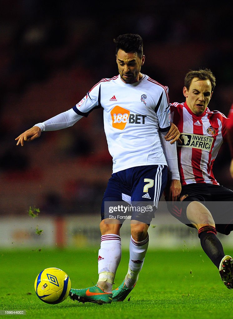 Bolton player <a gi-track='captionPersonalityLinkClicked' href=/galleries/search?phrase=Chris+Eagles&family=editorial&specificpeople=214542 ng-click='$event.stopPropagation()'>Chris Eagles</a> (l) is challenged by Sunderland player David Vaughan during the FA Cup Third Round Replay between Sunderland and Bolton Wanderers at Stadium of Light on January 15, 2013 in Sunderland, England.