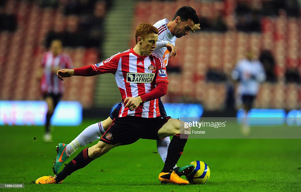 Bolton player Chris Eagles (r) is challenged by Sunderland player <a gi-track='captionPersonalityLinkClicked' href=/galleries/search?phrase=Jack+Colback&family=editorial&specificpeople=4940395 ng-click='$event.stopPropagation()'>Jack Colback</a> during the FA Cup Third Round Replay between Sunderland and Bolton Wanderers at Stadium of Light on January 15, 2013 in Sunderland, England.