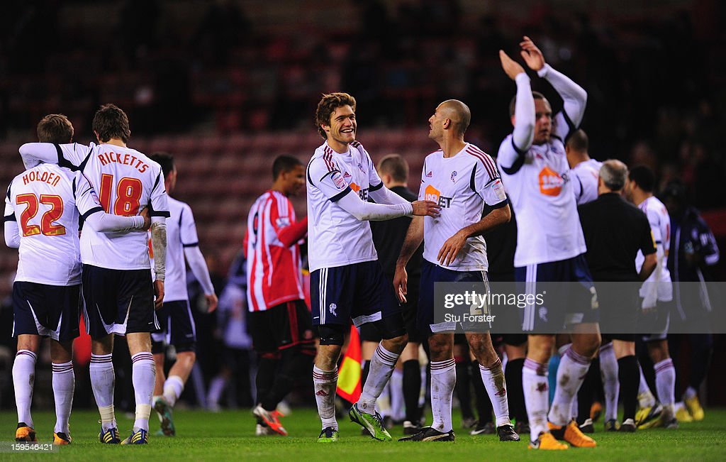 Bolton player <a gi-track='captionPersonalityLinkClicked' href=/galleries/search?phrase=Marcos+Alonso&family=editorial&specificpeople=3648323 ng-click='$event.stopPropagation()'>Marcos Alonso</a> (l) congratulates Darren Pratley after the FA Cup Third Round Replay between Sunderland and Bolton Wanderers at Stadium of Light on January 15, 2013 in Sunderland, England.