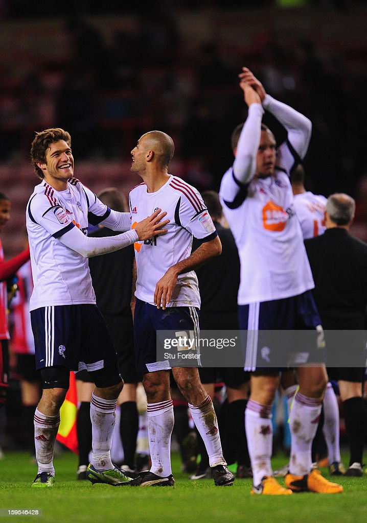 Bolton player Marcos Alonso (l) congratulates Darren Pratley after the FA Cup Third Round Replay between Sunderland and Bolton Wanderers at Stadium of Light on January 15, 2013 in Sunderland, England.