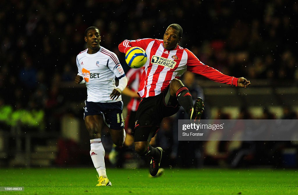 Bolton player Marvin Sordell (l) is beaten to the ball by Sunderland player <a gi-track='captionPersonalityLinkClicked' href=/galleries/search?phrase=Titus+Bramble&family=editorial&specificpeople=217707 ng-click='$event.stopPropagation()'>Titus Bramble</a> during the FA Cup Third Round Replay between Sunderland and Bolton Wanderers at Stadium of Light on January 15, 2013 in Sunderland, England.