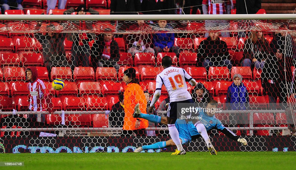 Bolton player Marvin Sordell scores from the penalty spot past Sunderland goalkeeper Simon Mignolet during the FA Cup Third Round Replay between Sunderland and Bolton Wanderers at Stadium of Light on January 15, 2013 in Sunderland, England.