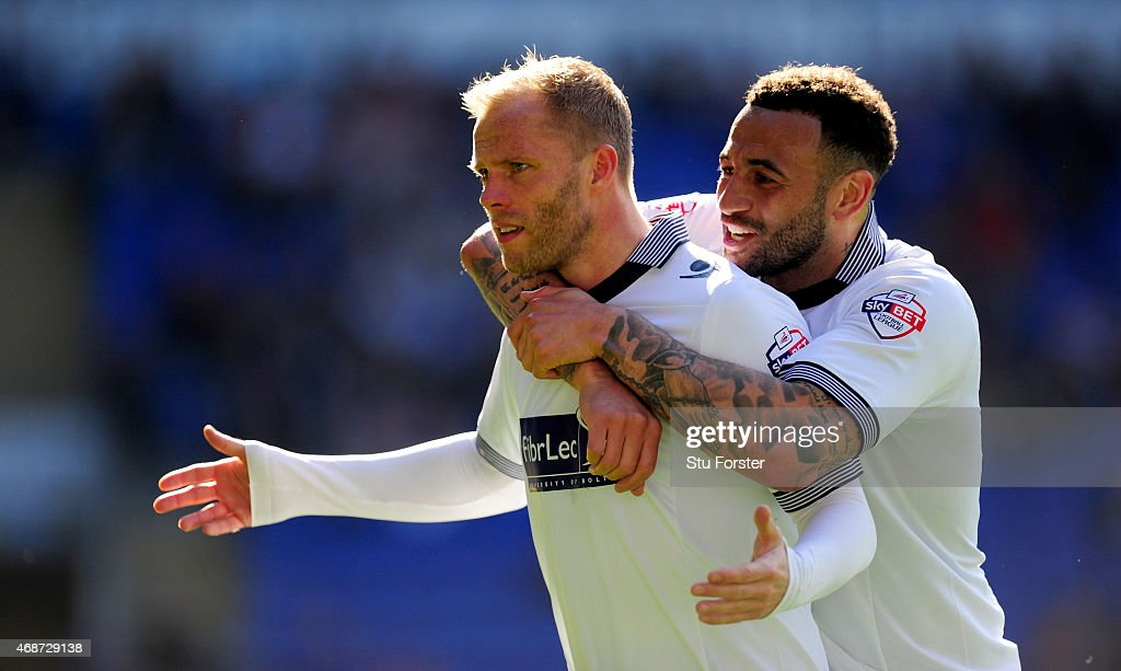 Bolton players <a gi-track='captionPersonalityLinkClicked' href=/galleries/search?phrase=Eidur+Gudjohnsen&family=editorial&specificpeople=171363 ng-click='$event.stopPropagation()'>Eidur Gudjohnsen</a> (l) and Craig Davies celebrate the first Bolton goal during the Sky Bet Championship match between Cardiff City and Bolton Wanderers at Cardiff City Stadium on April 6, 2015 in Cardiff, Wales.