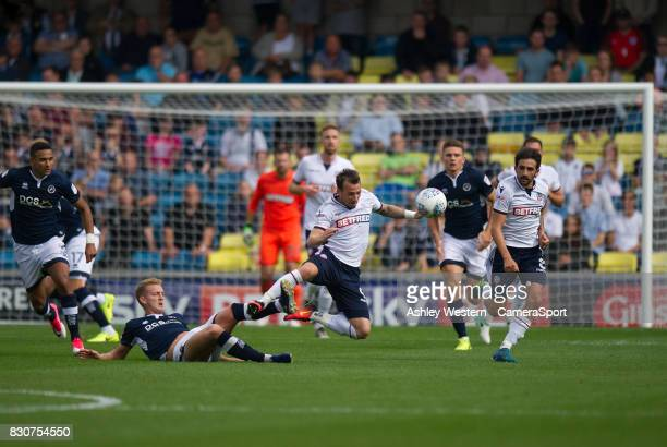 Bolton Wanderers' Adam Le Fondre is fouled by Millwall's George Saville during the Sky Bet Championship match between Millwall and Bolton Wanderers...