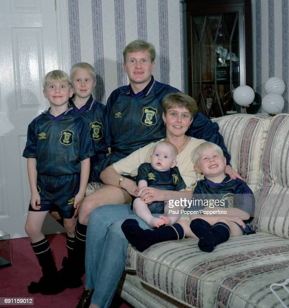 Bolton Wanderers and Scotland footballer John McGinlay with his wife Lee and their children at home circa May 1996 John and the children are all...