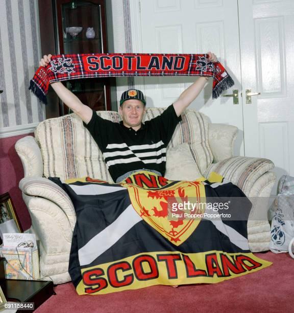 Bolton Wanderers and Scotland striker John McGinlay in patriotic mood at his home circa May 1996