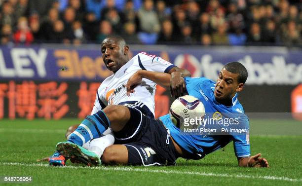 Bolton Wanderers Benik Afobe battles for the ball with Leeds United's Lee Peltier during the npower Championship match at the Reebok Stadium Bolton