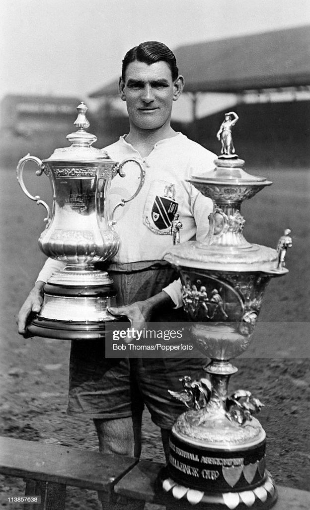 Bolton Wanderers captain Joe Smith holding the FA Cup at Burnden Park in Bolton, circa May 1923.