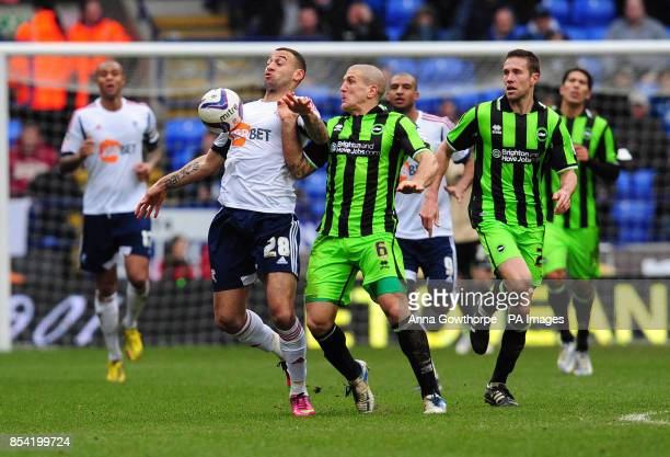 Bolton Wanderers' Craig Davies and Brighton and Hove Albion's Adam ElAbd in action during the npower Football League Championship match at The Reebok...