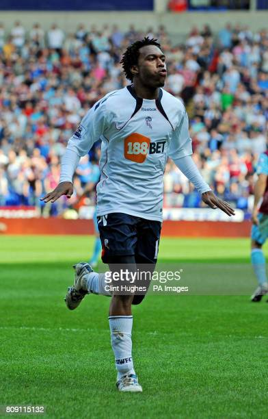 Bolton Wanderers' Daniel Sturridge celebrates after scoring his sides third goal of the game during the Barclays Premier League match at the Reebok...