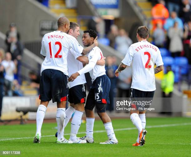 Bolton Wanderers' Daniel Sturridge celebrates with teammates after he scored the opening goal during the Barclays Premier League match at the Reebok...