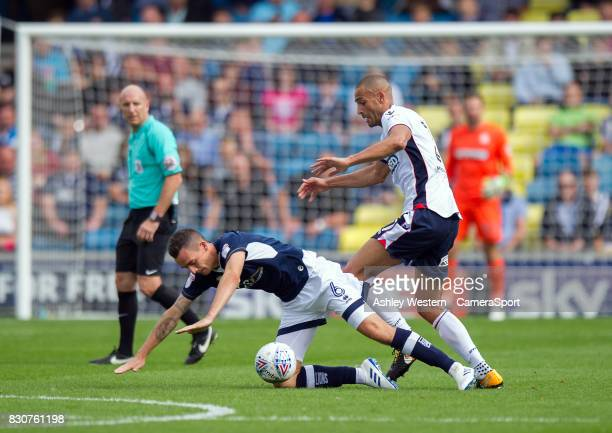 Bolton Wanderers' Darren Pratley battles for possession with Millwall's Shaun Williams during the Sky Bet Championship match between Millwall and...