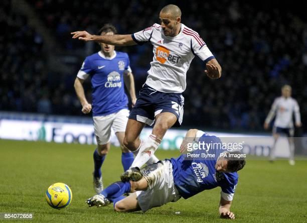 Bolton Wanderers' Darren Pratley skips over a challenge from Everton's Phil Jagielka