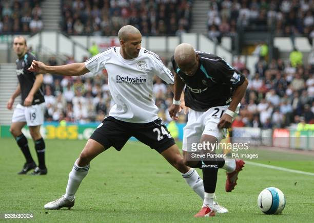 Bolton Wanderers' ElHadji Diouf and Derby County's Tyrone Mears battle for the ball