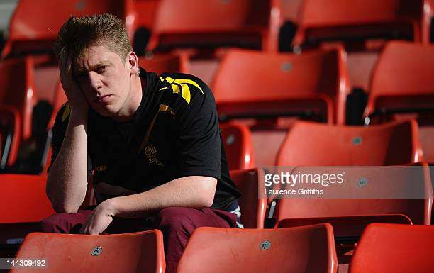 Bolton Wanderers fan looks dejected as they are relegated during the Barclays Premier League match between Stoke City and Bolton Wanderers at...
