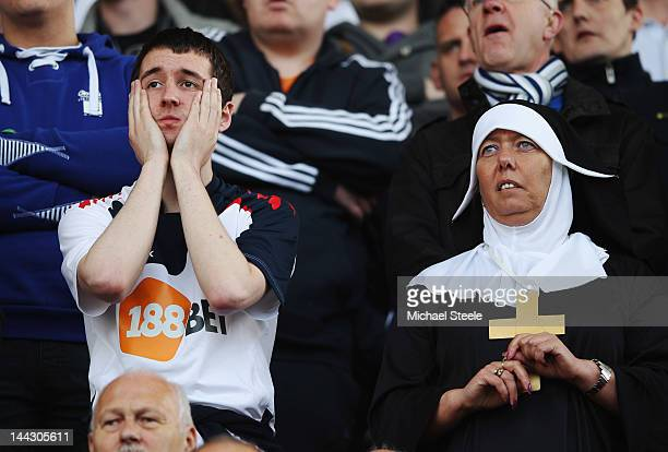 Bolton Wanderers fans look nervous during the Barclays Premier League match between Stoke City and Bolton Wanderers at Britannia Stadium on May 13...