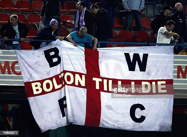 Bolton Wanderers fans remove their flag from the stand after drawing 00 in the UEFA Cup Round of 32 Second Leg match between Atletico Madrid and...