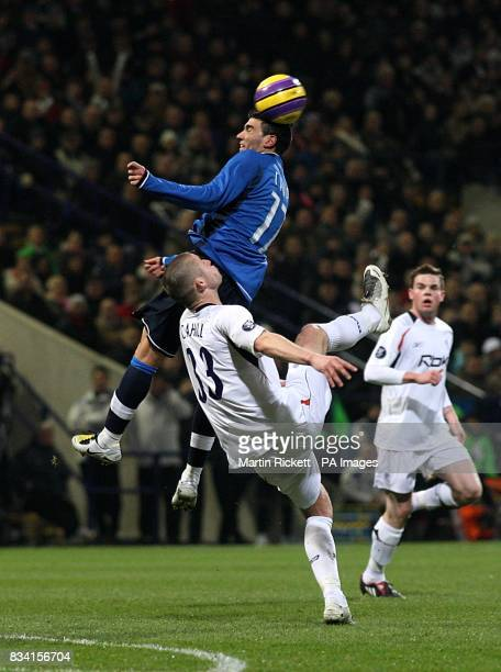 Bolton Wanderers' Gary Cahill and Atletico Madrid's Jose Antonio Reyes battle for the ball in the air