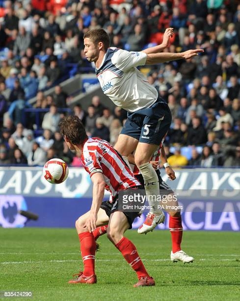 Bolton Wanderers' Gary Cahill and Sunderland's Dean Whitehead battle for the ball