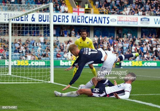 Bolton Wanderers' Gary Madine battles for possession with Millwall's Byron Webster during the Sky Bet Championship match between Millwall and Bolton...