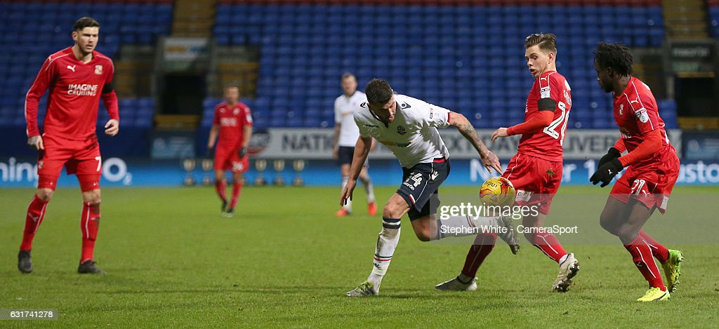 Bolton Wanderers' Gary Madine battles with Swindon Town's Charlie Colkett during the Sky Bet League One match between Bolton Wanderers and Swindon Town at Macron Stadium on January 14, 2017 in Bolton, England.