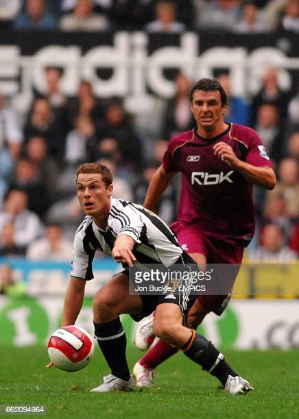 Bolton Wanderers Gary Speed chases Newcastle United's Scott Parker